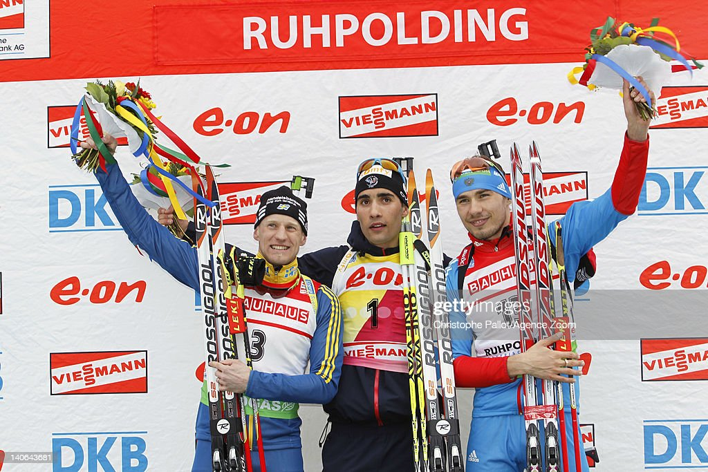 Martin Fourcade of France takes 1st place, Carl Johan Bergman of Sweden takes 2nd place, Anton Shipulin of Russia takes 3rd place competes during the IBU Biathlon World Championships Men's Pursuit on March 04, 2012 in Ruhpolding, Germany.