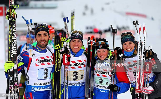 Martin Fourcade Quentin Fillon Maillet Marie Dorin Habert and Anais Bescond of France celebrate winning the gold medal during the IBU Biathlon World...