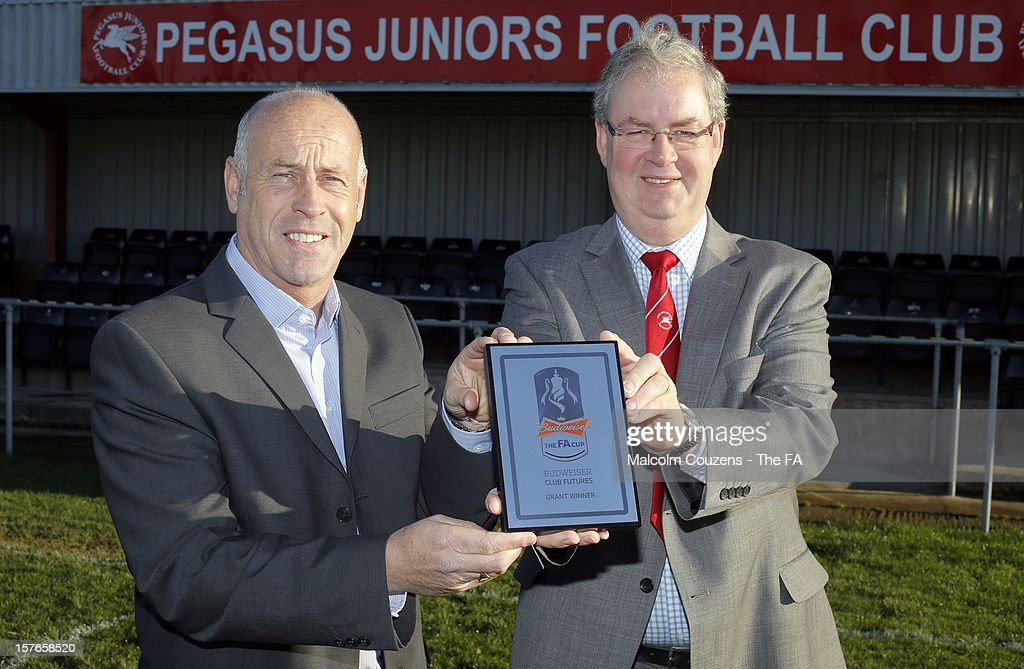 Martin Foyle (left) the regional Club Futures ambassador for the West Midlands pictured in front of the main stand with Kevin Bishop, chief executive of Pegasus Juniors FC, during the Bud Club Futures event at Pegasus Juniors FC on December 5, 2012 in Hereford, England. Football life is set to change for Pegasus Juniors as Newcastle United boss Alan Pardew, Budweiser and the FA have today announced the winners of the £50,000 grants as part of the Budweiser Club Futures Programme. Pegasus Juniors FC to redevelop clubhouse through £50k cash injection from grass roots football programme.
