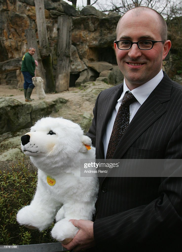 Martin Frechen director of toy manufacturer Steiff presents a Knut polar bear toy as the real life Knut plays in his enclosure at Berlin's...