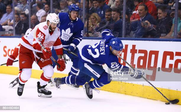 Martin Frk of the Detroit Red Wings and Nikita Zaitsev of the Toronto Maple Leafs battle for the puck during the third period at the Air Canada...