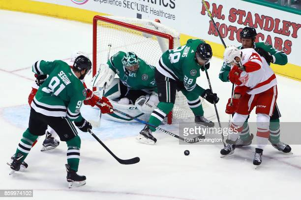 Martin Frk of the Detroit Red Wings battles for the puck against Tyler Seguin of the Dallas Stars Ben Bishop of the Dallas Stars Stephen Johns of the...