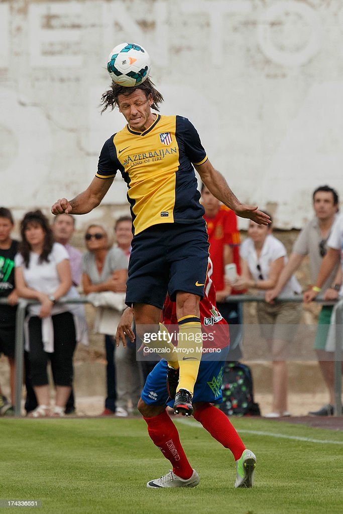 Martin G. Demichelis of Atletico de Madrid heads the ball during the Jesus Gil y Gil Trophy between Club Atletico de Madrid and Numancia C. D. at Sporting Club Uxama on July 21, 2013 in Burgo de Osma, Soria, Spain.