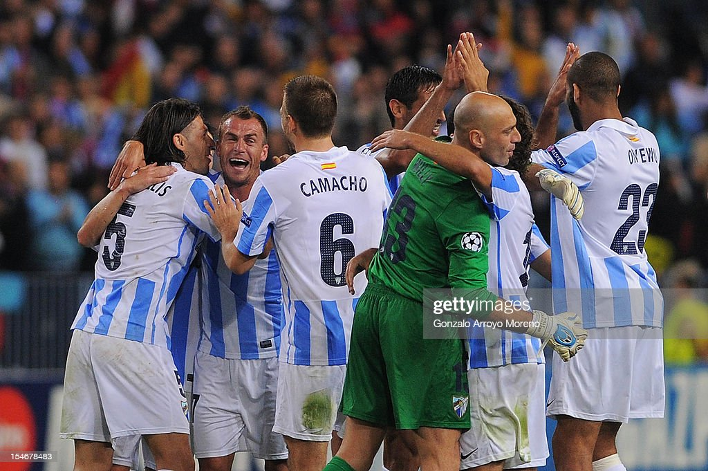 Martin G. Demichelis (L) of Malaga CF celebrates victory with teammates Joaquin Sanchez (2ndL), Ignacio Camacho (3dL), goalkeeper <a gi-track='captionPersonalityLinkClicked' href=/galleries/search?phrase=Willy+Caballero&family=editorial&specificpeople=7800140 ng-click='$event.stopPropagation()'>Willy Caballero</a> (3dR) and <a gi-track='captionPersonalityLinkClicked' href=/galleries/search?phrase=Oguchi+Onyewu&family=editorial&specificpeople=4136175 ng-click='$event.stopPropagation()'>Oguchi Onyewu</a> (R) during the UEFA Champions League group C match between Malaga CF and AC Milan at the Estadio La Rosaleda on October 24, 2012 in Malaga, Spain.