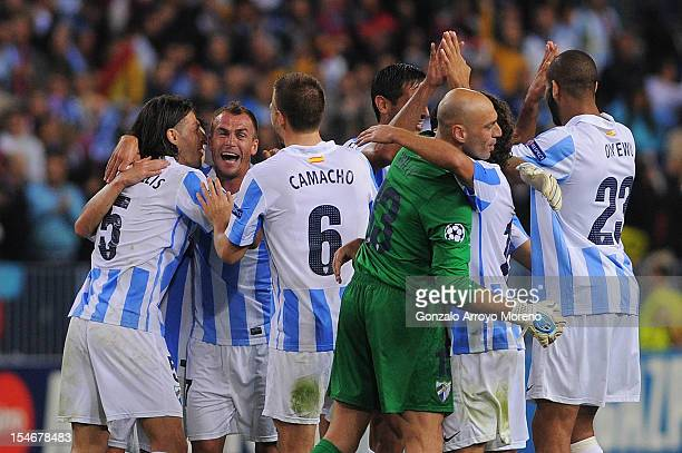 Martin G Demichelis of Malaga CF celebrates victory with teammates Joaquin Sanchez Ignacio Camacho goalkeeper Willy Caballero and Oguchi Onyewu...