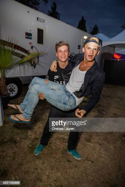 Martin Garrix and musician Cody Simpson pose backstage during HARD Summer at Whittier Narrows Recreation Area on August 3 2014 in Los Angeles...
