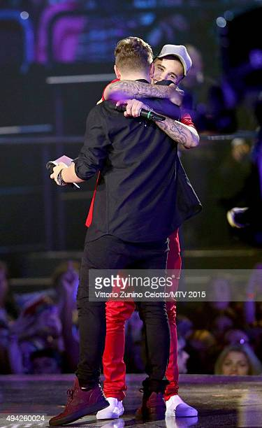 Martin Garrix greets Justin Bieber accepting the award for Best Collaboration from on stage during the MTV EMA's 2015 at the Mediolanum Forum on...