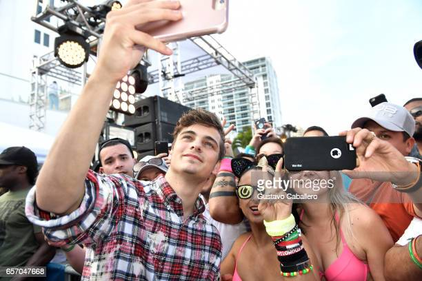Martin Garrix takes a selfie with fans at the SiriusXM Music Lounge at 1 Hotel South Beach on March 23 2017 in Miami Florida