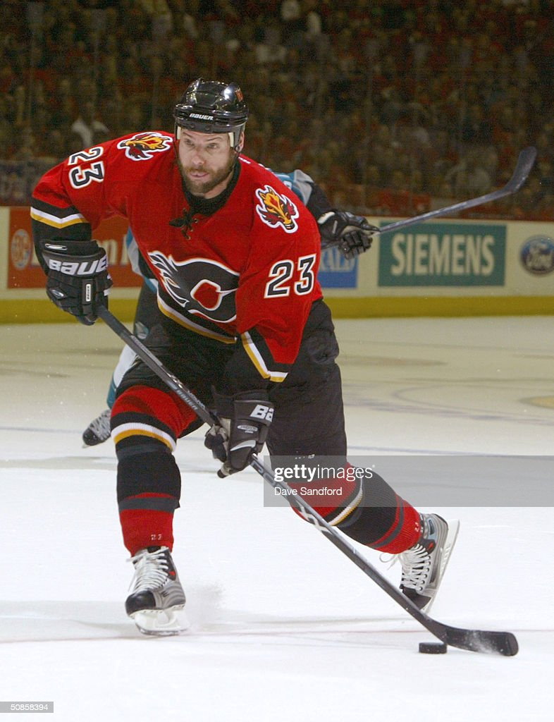 Martin Gelinas #22 of the Calgary Flames breaks away and scores against the San Jose Sharks in Game six of the 2004 NHL Western Conference Finals during the Stanley Cup Playoffs on May 19, 2004 at the Pengrowth Saddledome in Calgary, Alberta.
