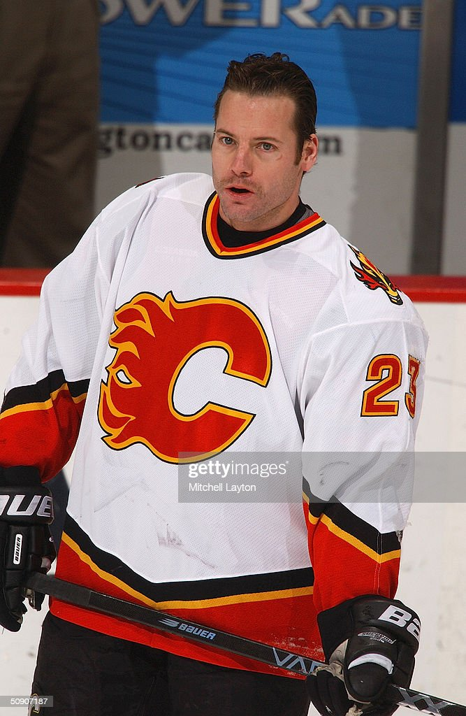 Martin Gelinas #23 of the Calgary Flames looks on during warmups before the game against the Washington Capitals on January 14, 2004 at the MCI Center in Washington, D.C. The Flames and the Capitals tied 3-3.
