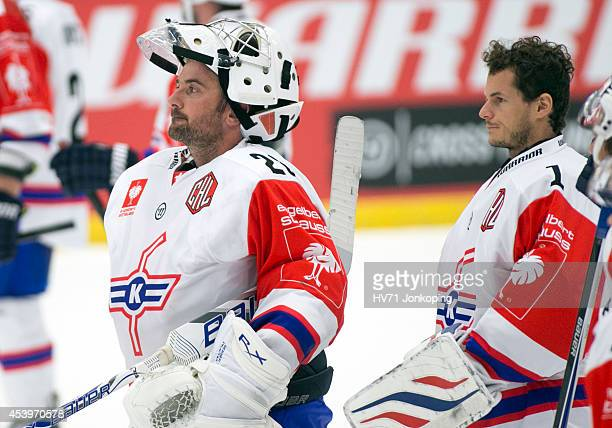 Martin Gerber Goaltender of Kloten Flyers and Jonas Müller Goaltender of Kloten Flyers are disappointed after losing to HV71 with 23 during the...