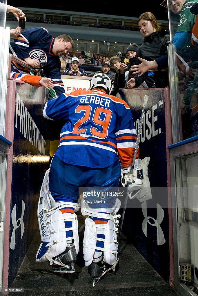 <a gi-track='captionPersonalityLinkClicked' href=/galleries/search?phrase=Martin+Gerber&family=editorial&specificpeople=206957 ng-click='$event.stopPropagation()'>Martin Gerber</a> #29 of the Edmonton Oilers leaves the ice after warm-up before a game against the San Jose Sharks at Rexall Place on November 27, 2010 in Edmonton, Alberta, Canada.