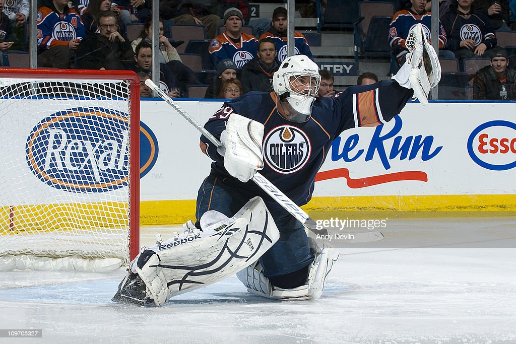 <a gi-track='captionPersonalityLinkClicked' href=/galleries/search?phrase=Martin+Gerber&family=editorial&specificpeople=206957 ng-click='$event.stopPropagation()'>Martin Gerber</a> #29 of the Edmonton Oilers makes one of his 34 saves to earn his third straight win, against the Nashville Predators at Rexall Place on March 1, 2011 in Edmonton, Alberta, Canada.