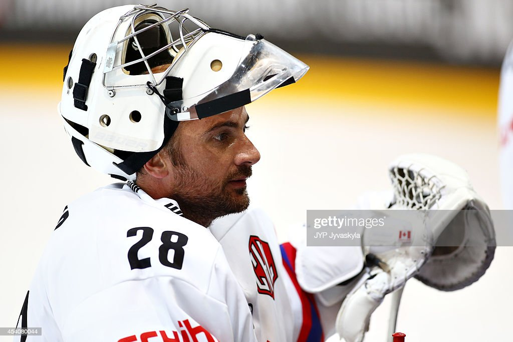 <a gi-track='captionPersonalityLinkClicked' href=/galleries/search?phrase=Martin+Gerber&family=editorial&specificpeople=206957 ng-click='$event.stopPropagation()'>Martin Gerber</a> of the Kloten Flyers leaves the net during the Champions Hockey League group stage game against JYP Jyvaskyla August 24, 2014 in Jyvaskyla, Finland.