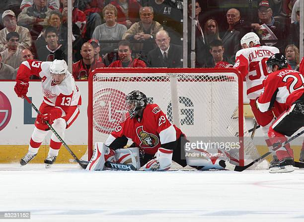 Martin Gerber of the Ottawa Senators makes a pad save on a wraparound attempt by Pavel Datsyuk of the Detroit Red Wings at Scotiabank Place on...