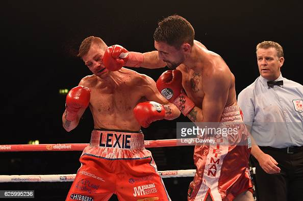 Martin Gethin throws a punch on John Wayne Hibbert during the IBF Super International Lightweight contest at Wembley Arena on November 26 2016 in...