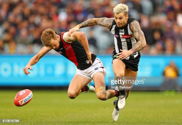 Martin Gleeson of the Bombers and Jamie Elliott of the Magpies compete for the ball during the round 16 AFL match between the Collingwood Magpies and...