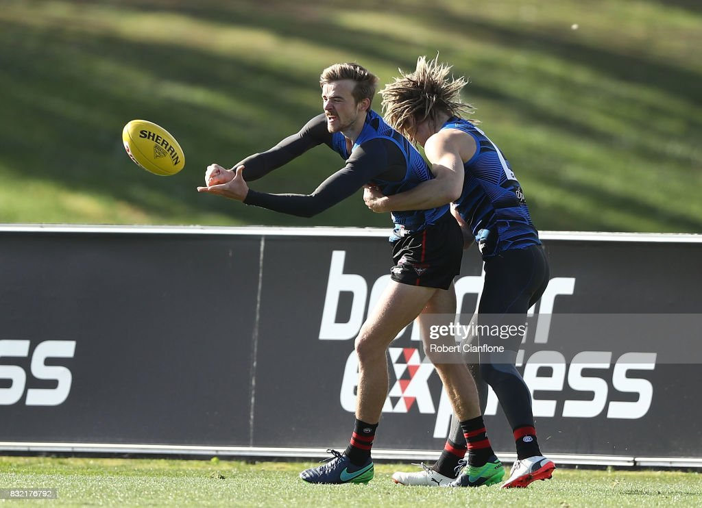 Martin Gleeson of the Bombers handballs during an Essendon Bombers AFL training session at the Essendon Football Club on August 16, 2017 in Melbourne, Australia.