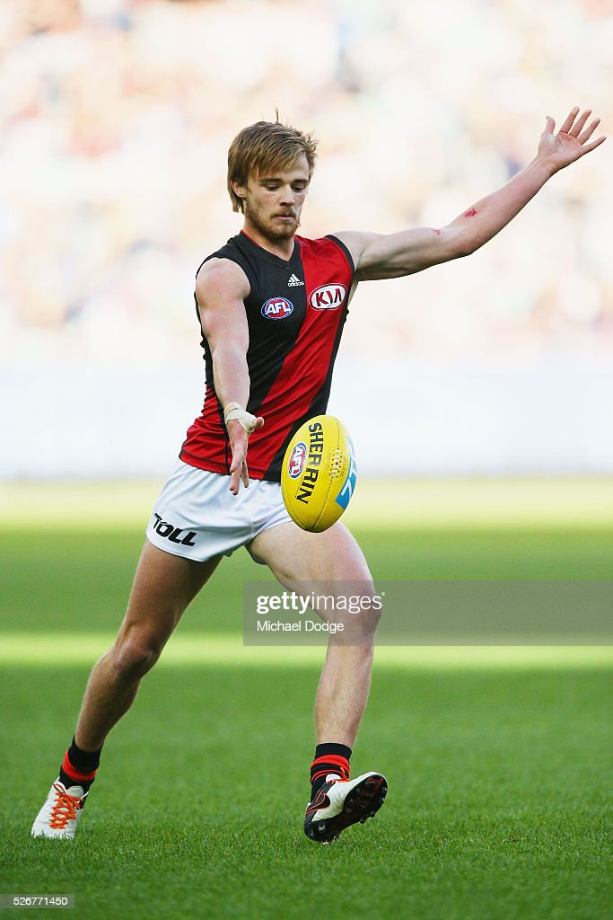 Martin Gleeson of the Bombers kicks the ball during the round six AFL match between the Carlton Blues and the Essendon Bombers at Melbourne Cricket Ground on May 1, 2016 in Melbourne, Australia.