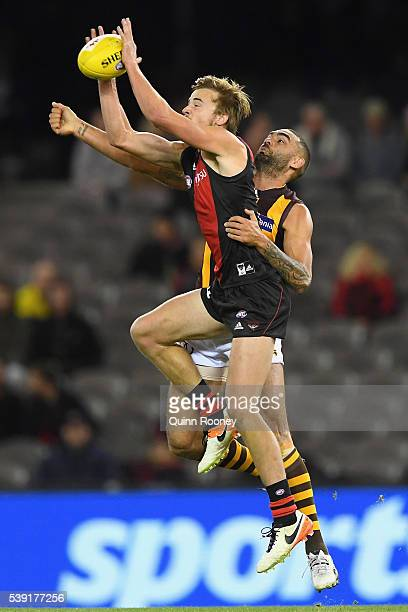 Martin Gleeson of the Bombers marks infront of Shaun Burgoyne of the Hawks during the round 12 AFL match between the Essendon Bombers and the...