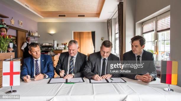 Martin Glenn FA Chairman Greg Clarke DFB president Reinhard Grindel and DFB general secretary Friedrich Curtius sign a memorandum of understanding...