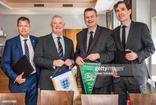 Martin Glenn FA Chairman Greg Clarke DFB president Reinhard Grindel and DFB general secretary Friedrich Curtius pose after signing a memorandum of...
