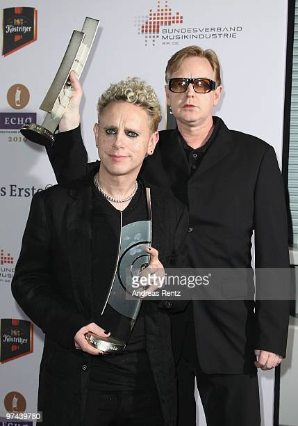 Martin Gore and Andrew Fletcher of the band Depeche Mode pose with the Echo award 2010 at the Messe Berlin on March 4 2010 in Berlin Germany