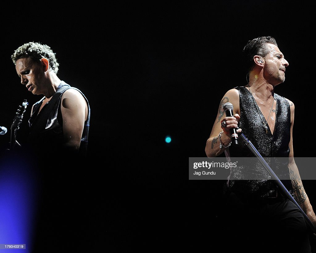 Martin Gore and Dave Gahan of Depeche Mode on stage during 'The Delta Machine Tour' at the Molson Canadian Amphitheatre on September 1 2013 in...