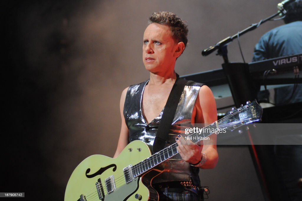 <a gi-track='captionPersonalityLinkClicked' href=/galleries/search?phrase=Martin+Gore&family=editorial&specificpeople=537532 ng-click='$event.stopPropagation()'>Martin Gore</a> of Depeche Mode performs on stage at Leeds Arena on November 13, 2013 in Leeds, England.