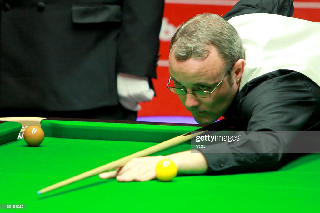 Martin Gould of England plays a shoot against Marco Fu of China during day four of the The Dafabet World Snooker Championship at Crucible Theatre on April 22, 2014 in Sheffield, England.