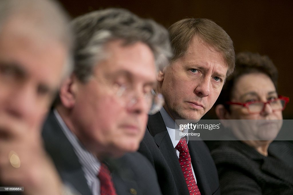 Martin Gruenberg, chairman of the Federal Deposit Insurance Corp. (FDIC), left to right, Thomas Curry, comptroller of the U.S. currency, Richard Cordray, director of the Consumer Financial Protection Bureau (CFPB), and Elisse Walter, chairman of the Securities and Exchange Commission (SEC), listen to a question during a Senate Banking Committee hearing in Washington, D.C., U.S., on Thursday, Feb. 14, 2013. U.S. regulators told lawmakers they are making significant progress to prevent a repeat of the 2008 credit crisis, pushing back against complaints of slow progress and efforts to undo parts of the Dodd-Frank Act. Photographer: Andrew Harrer/Bloomberg via Getty Images
