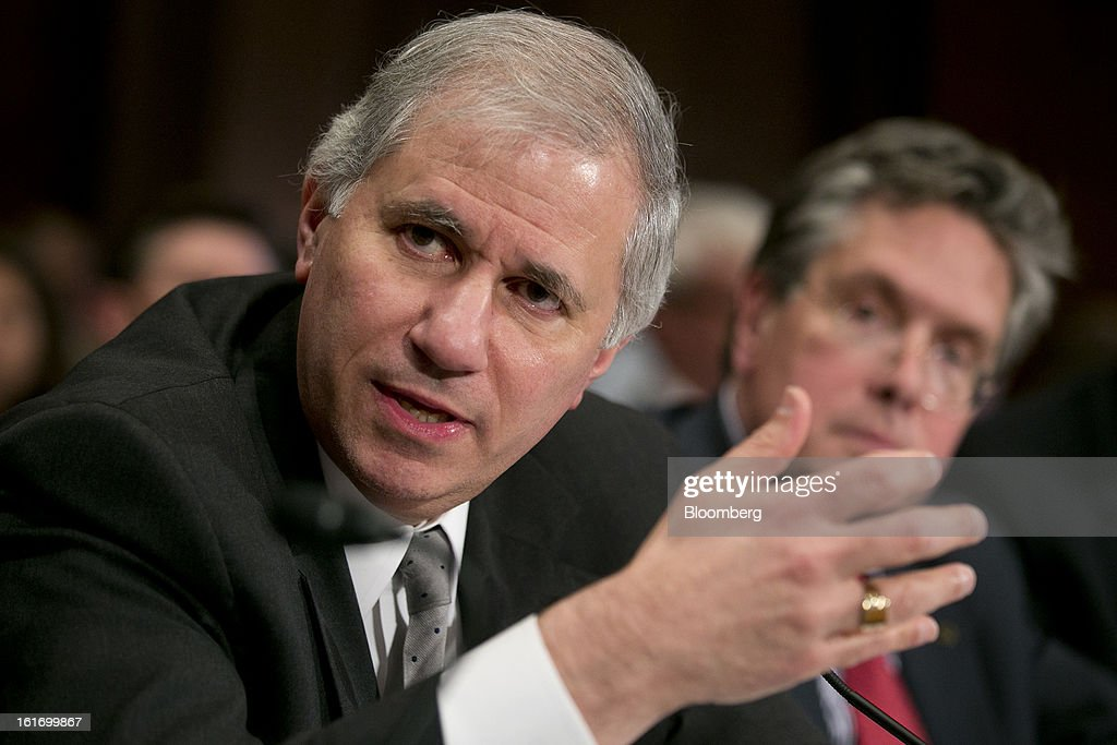 Martin Gruenberg, chairman of the Federal Deposit Insurance Corp. (FDIC), left, speaks during a Senate Banking Committee hearing while Thomas Curry, comptroller of the U.S. currency, listens in Washington, D.C., U.S., on Thursday, Feb. 14, 2013. U.S. regulators told lawmakers they are making significant progress to prevent a repeat of the 2008 credit crisis, pushing back against complaints of slow progress and efforts to undo parts of the Dodd-Frank Act. Photographer: Andrew Harrer/Bloomberg via Getty Images