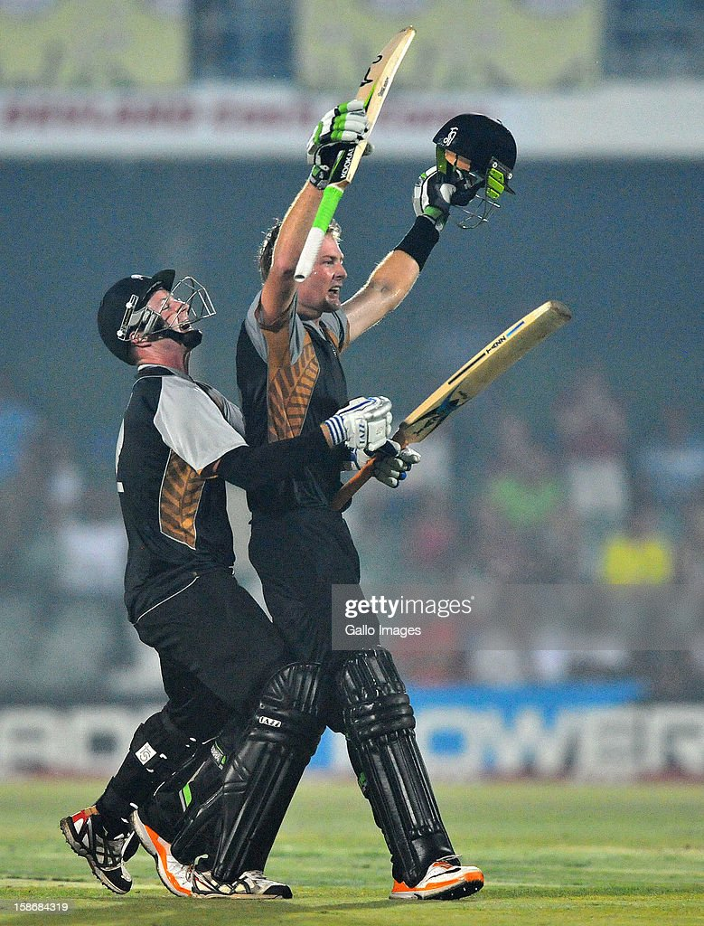 Martin Guptil of New Zealand celebrates his 100 with Colin Munro off the last ball to win the match during the 2nd T20 match between South Africa and New Zealand at Buffalo Park on December 23, 2012 in East London, South Africa.