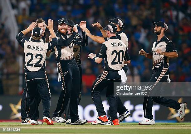 Martin Guptil of New Zealand is congratulated by his team mates after he takes the catch of Suresh Raina of India during the ICC World Twenty20 India...