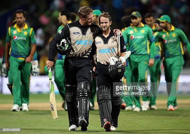 Martin Guptill and Kane Williamson of New Zealand celebrate winning the second Twenty20 cricket match between New Zealand and Pakistan at Seddon Park...