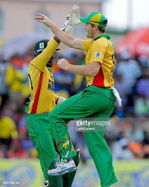 Martin Guptill of Guyana Amazon Warriors celebrates catching Dwayne Smith of the Barbados Tridents during the Limacol Caribbean Premier League 2014...