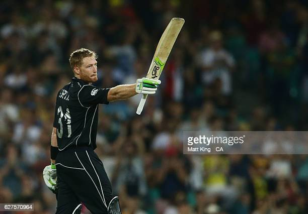 Martin Guptill of New Zealand celebrates and acknowledges the crowd after scoring a century during game one of the One Day International series...