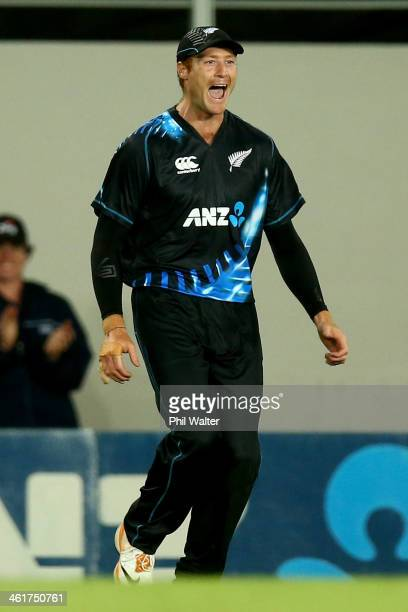 Martin Guptill of New Zealand celebrates his catch of Andre Russell of the West Indies during the first T20 between New Zealand and the West Indies...