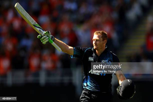 Martin Guptill of New Zealand celebrates his century during the One Day International match between New Zealand and India at Eden Park on January 25...