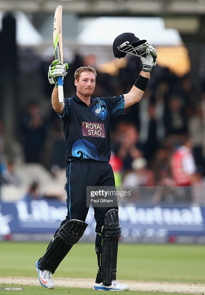 <a gi-track='captionPersonalityLinkClicked' href=/galleries/search?phrase=Martin+Guptill&family=editorial&specificpeople=797559 ng-click='$event.stopPropagation()'>Martin Guptill</a> of New Zealand celebrates hitting a four to make a century and win the match for New Zealand giving him a total of 103 runs during the first Natwest Series One Day International match between England and New Zealand at Lord's Cricket Ground on May 31, 2013 in London, England.