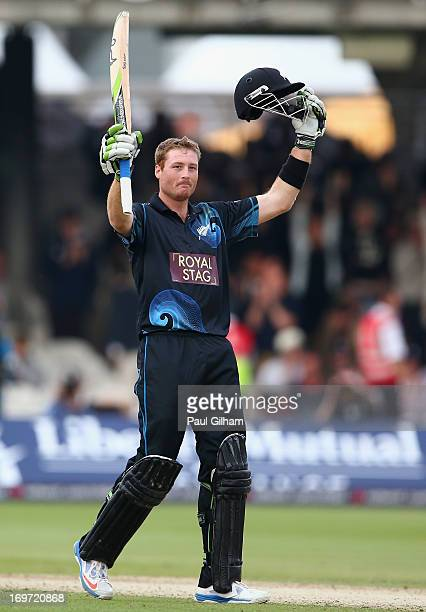 Martin Guptill of New Zealand celebrates hitting a four to make a century and win the match for New Zealand giving him a total of 103 runs during the...
