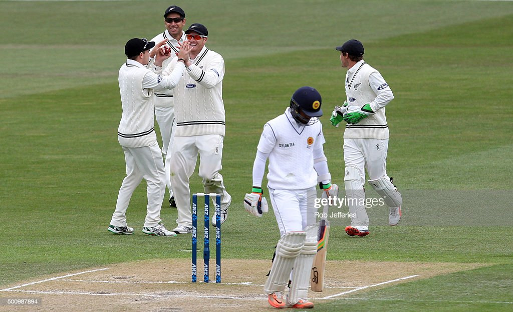 <a gi-track='captionPersonalityLinkClicked' href=/galleries/search?phrase=Martin+Guptill&family=editorial&specificpeople=797559 ng-click='$event.stopPropagation()'>Martin Guptill</a> of New Zealand celebrates taking a catch with Tom Latham, <a gi-track='captionPersonalityLinkClicked' href=/galleries/search?phrase=Ross+Taylor&family=editorial&specificpeople=845922 ng-click='$event.stopPropagation()'>Ross Taylor</a> and <a gi-track='captionPersonalityLinkClicked' href=/galleries/search?phrase=BJ+Watling&family=editorial&specificpeople=2115739 ng-click='$event.stopPropagation()'>BJ Watling</a> to dismiss <a gi-track='captionPersonalityLinkClicked' href=/galleries/search?phrase=Dinesh+Chandimal&family=editorial&specificpeople=4884949 ng-click='$event.stopPropagation()'>Dinesh Chandimal</a> of Sri Lanka during day three of the First Test match between New Zealand and Sri Lanka at University Oval on December 12, 2015 in Dunedin, New Zealand.