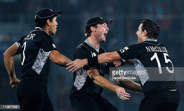 Martin Guptill of New Zealand celebrates with team mate Nathan McCullum after running out AB de Villiers of South Africa during the 2011 ICC World...