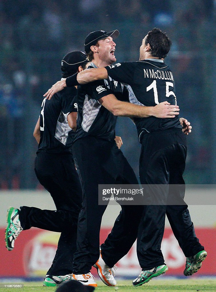 <a gi-track='captionPersonalityLinkClicked' href=/galleries/search?phrase=Martin+Guptill&family=editorial&specificpeople=797559 ng-click='$event.stopPropagation()'>Martin Guptill</a> of New Zealand celebrates with team mate <a gi-track='captionPersonalityLinkClicked' href=/galleries/search?phrase=Nathan+McCullum&family=editorial&specificpeople=884481 ng-click='$event.stopPropagation()'>Nathan McCullum</a> after running out AB de Villiers of South Africa during the 2011 ICC World Cup Quarter-Final match between New Zealand and South Africa at Shere-e-Bangla National Stadium on March 25, 2011 in Dhaka, Bangladesh.
