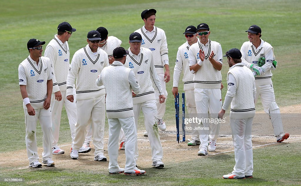 Martin Guptill of New Zealand is congratulated by his teammates after being named man of the match on day five of the First Test match between New...