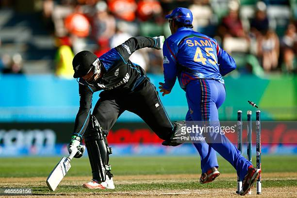 Martin Guptill of New Zealand is run out during the 2015 ICC Cricket World Cup match between New Zealand and Afghanistan at McLean Park on March 8...