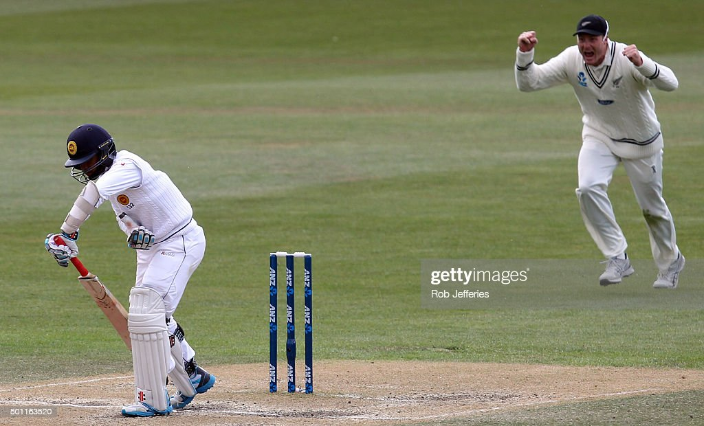 Martin Guptill of New Zealand reacts to this dismissal of Kusal Mendis of Sri Lanka during day four of the First Test match between New Zealand and...