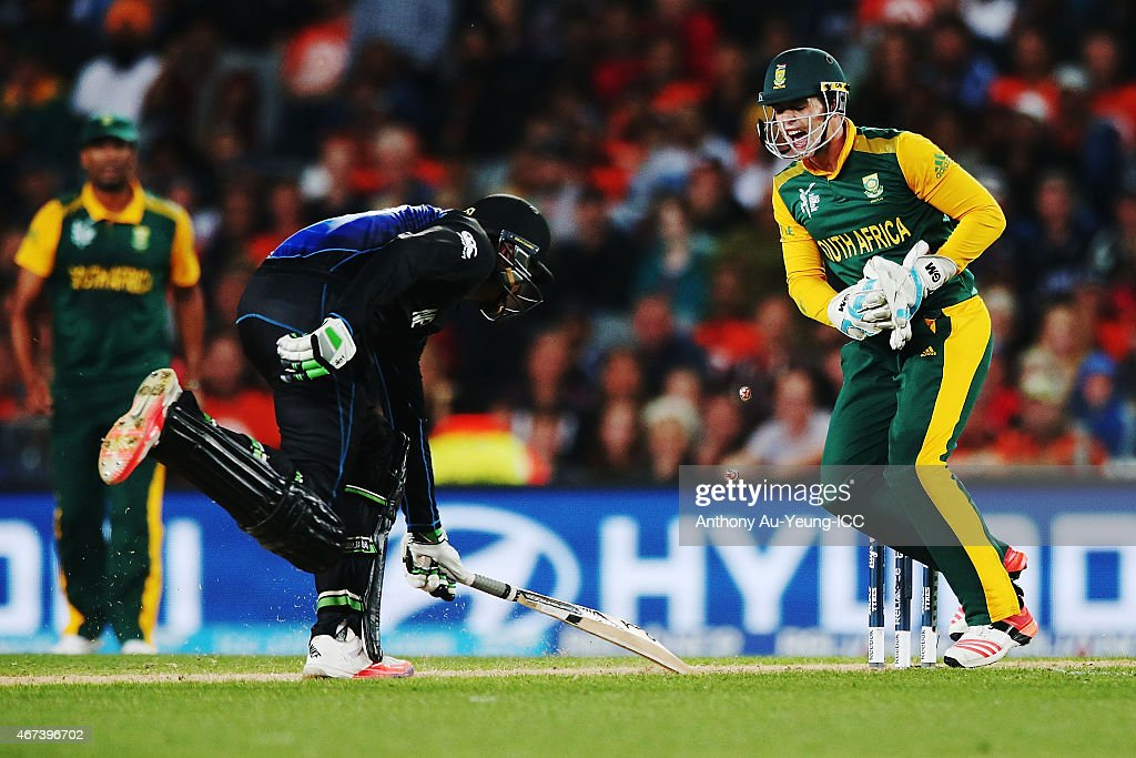 Martin Guptill of New Zealand runout as Quinton de Kock of South Africa reacts during the 2015 Cricket World Cup Semi Final match between New Zealand...