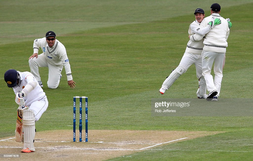 <a gi-track='captionPersonalityLinkClicked' href=/galleries/search?phrase=Martin+Guptill&family=editorial&specificpeople=797559 ng-click='$event.stopPropagation()'>Martin Guptill</a> of New Zealand successfully takes a catch off the bowling of Tim Southee to dismiss <a gi-track='captionPersonalityLinkClicked' href=/galleries/search?phrase=Dinesh+Chandimal&family=editorial&specificpeople=4884949 ng-click='$event.stopPropagation()'>Dinesh Chandimal</a> of Sri Lanka during day three of the First Test match between New Zealand and Sri Lanka at University Oval on December 12, 2015 in Dunedin, New Zealand.