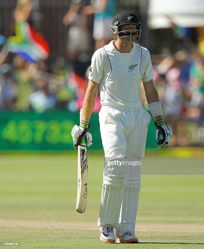 Martin Guptill of New Zealand walks off after losing his wicket for 48 runs on the third day of the second and final test match between South Africa and New Zealand at the Axxess St George's Cricket Stadium on January 13, 2013 in Port Elizabeth. AFP Photo / Anesh Debiky